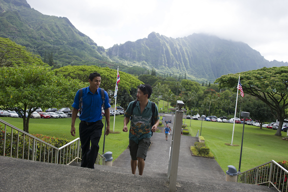 2 Students walking up stairs at the Hawaii Loa Campus at the foot of the Ko'olau Range